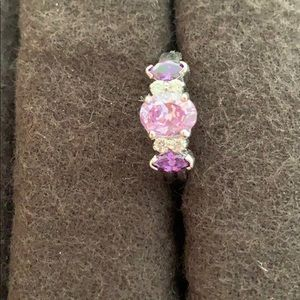 Silver ring with light and dark purple gems